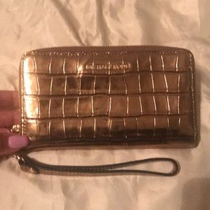 Gold Michael Kors wristlet/wallet